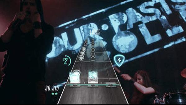 guitar-hero-est-disponible-sur-lapple-tv-la-guitare-est-indispensable