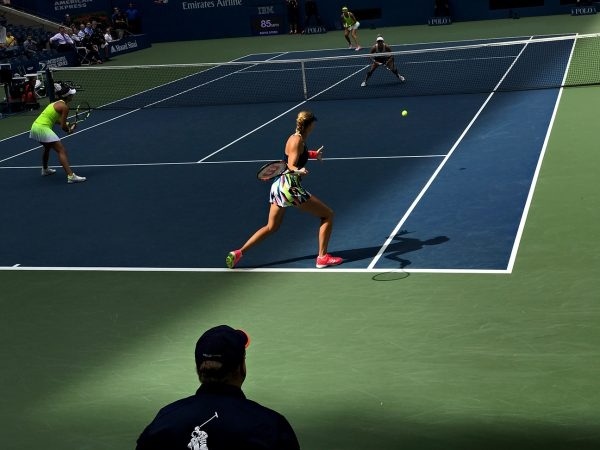 NEW YORK, NY - SEPTEMBER 11: Caroline Garcia (FRA) and Kristina Mladenovic (FRA) serve to Bethanie Mattek-Sands (USA) [12] and Lucie Safarova (CZE) [12] during the women's doubles finals in Arthur Ashe as the roof casts a shadow across the court on Day 14 of the 2016 US Open at the USTA Billie Jean King National Tennis Center on September 11, 2016 in Queens. (Landon Nordeman for ESPN)