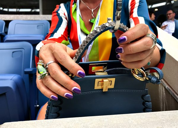 NEW YORK, NY - SEPTEMBER 09: A tennis fan places her designer bag on a hanger in box seats at Arthur Ashe stadium during Day Twelve of the 2016 US Open at the USTA Billie Jean King National Tennis Center on September 9, 2016 in Queens. (Landon Nordeman for ESPN)